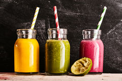 Three healthy fresh fruit and vegetable smoothies Royalty Free Stock Photo