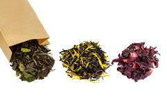 Three heaps of tea. On a white background Royalty Free Stock Images