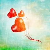 Three heart balloons fly in sky on tape Stock Photos