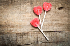 Three heart candies over wood Stock Image