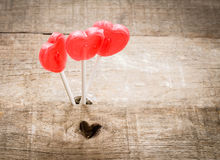 Three heart candies over wooden background Stock Image