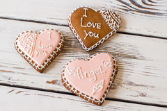 Three heart cookies. Glazed biscuits with inscription. Small gifts bring heart warmth. How to confess in love Stock Photos