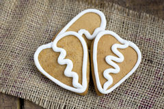 Three Heart  shape gingerbread Cookies on sacking Stock Image