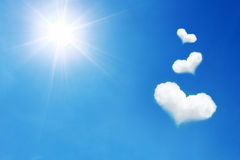three heart shaped cloud on blue sky with sunshine Royalty Free Stock Photography