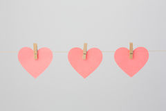 Heart-shaped Notes with Clothespins Royalty Free Stock Photography