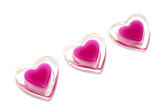 The three hearts. The three pink glass hearts Stock Photography