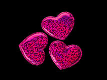 Three hearts on a black background Royalty Free Stock Image