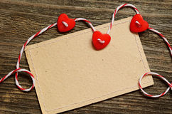 Three hearts and a card Stock Photo