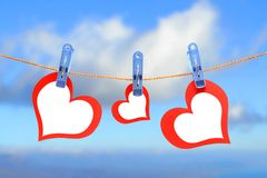 Three hearts drying on the rope Royalty Free Stock Photos