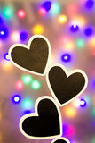 Three hearts in front of colorful background Royalty Free Stock Image