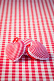 Three hearts on gingham tablecloth Royalty Free Stock Photo