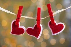 Three hearts hanging Royalty Free Stock Photography