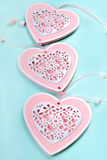 Three hearts on mint color background Stock Photo