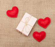 Three hearts and pink gift box Royalty Free Stock Photos