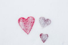 Three hearts on snow, Valentine`s Day Stock Images
