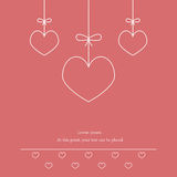 Three hearts on a string on a pink background. Love background. Love designs for greeting cards. Royalty Free Stock Images