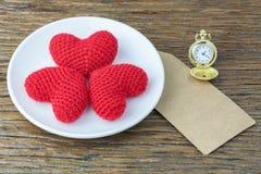 Three hearts. On a plate Stock Photos