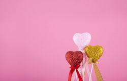 Three hearts together on pink. Background Royalty Free Stock Photo
