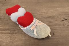 Three Hearts in Vintage Female Slipper Stock Images