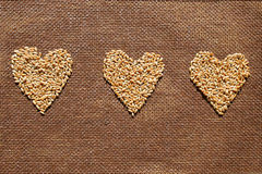 Three hearts from wheat grains Stock Images