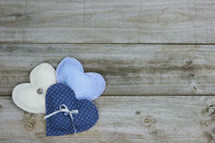 Three hearts on wood background Royalty Free Stock Photography