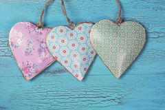 Three hearts. On a wooden background stock photo