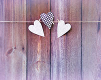 Three hearts on wooden background. Love message . Postcard, Vin. Rustic style. Romantic toning. Reverie. Three hearts on wooden background. Love message. Wedding stock photo
