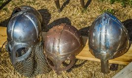 Three helmets with nose protection as worn by medieval knights in the Middle Ages.  stock image