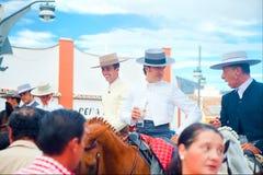 Three hidalgos at traditional fair Royalty Free Stock Photos