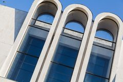 Three high concrete arches against blue sky. Elements of modern architecture. Three tall, narrow concrete arches against the blue sky Royalty Free Stock Photo