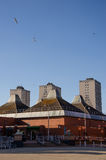 Three high residental apartments. Behind market place stock photo