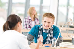 Three high school students in classroom Royalty Free Stock Image