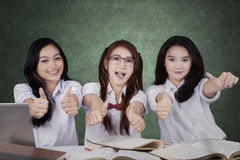 Three high school students showing thumbs up Stock Photography