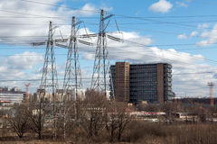 Three high voltage transmission towers stock photography