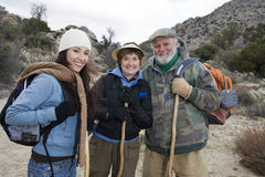 Three Hikers Hiking Stock Photography