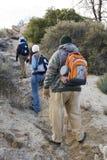 Three Hikers Hiking Stock Photo