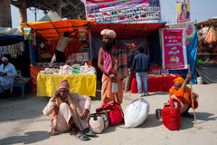 Three hindu men waiting on the sidelines Stock Photo