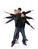 Three Hip Hop Young Men. With arms stretched over a white background Royalty Free Stock Photo