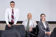 Three Hispanic business colleagues in boardroom Royalty Free Stock Images