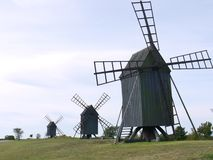 Three historic wind mills in a row Stock Photography