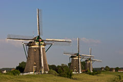 Three historic windmills. In a Dutch landscape Stock Photo