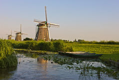 Three historic windmills. In a Dutch landscape Royalty Free Stock Images