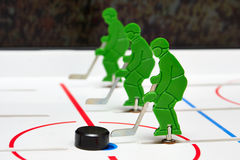 Three hockey players. In line with puck Royalty Free Stock Photo