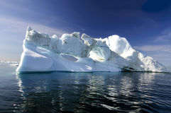 Three holes iceberg floating in Disko Bay. An iceberg is a large piece of freshwater ice that has broken off a glacier or an ice shelf and is floating freely in Stock Photos