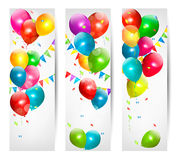 Three holiday banners with colorful balloons and c. Arnival flags. Vector Stock Image