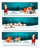 Three Holiday Christmas banners with a gift boxes. And Santa Claus. Vector Stock Photography