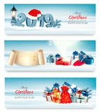 Three Holiday Christmas banners with 2019 and gift boxes. stock illustration