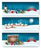 Three Holiday Christmas banners with a winter village stock illustration