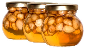 Three honey jars Royalty Free Stock Image