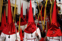 Three Hooded Sinners in Catholic Parade. The Semana Santa Processions in Spain Stock Image
